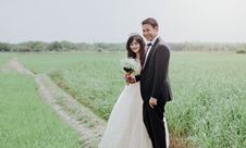 Free Man And Woman Wearing Wedding Dress And Suit In Between Of Rice Fields Stock Images - 109916244