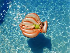 Free Girl Wearing Green Wet Suit Riding Inflatable Orange Life Buoy On Top Of Body Of Water Stock Photos - 109916343