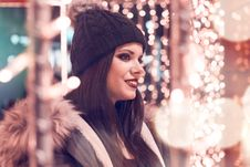 Free Selective Focus Photography Of Woman Wearing Black Cap And Gray Parka Jacket Surrounded By Lights Stock Image - 109916381