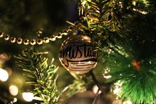 Free Gold Printed Bauble On Christmas Tree Royalty Free Stock Photo - 109916425