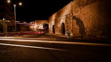 Free Brown Concrete Wall During Night Time Photo Royalty Free Stock Photo - 109916435