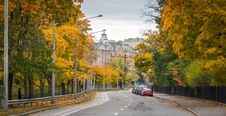 Free Gray And Blue Concrete Building Surrounded With Yellow Leafed Trees At Daytime Stock Photography - 109916452