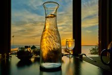 Free Clear Wine Glass And Clear Glass Pitcher Stock Image - 109916491
