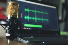 Free Gold Condenser Microphone Near Laptop Computer Stock Photos - 109916493