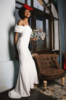 Free Woman In White Off-shoulder Gown Holding Bouquet Of White Flowers Stock Photography - 109916692