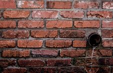 Free Round Brown Pipe Drainage With Liquid In Brown Bricked Concrete Wall Royalty Free Stock Image - 109916776
