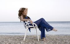 Free Woman Wearing Blue Two-piece Dress Sitting On White Armchair Near Beach Stock Photography - 109916902