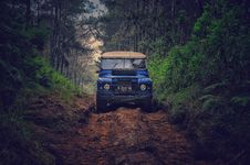 Free Blue Car On Dirt Road Between Green Leaf Trees Royalty Free Stock Photography - 109917047