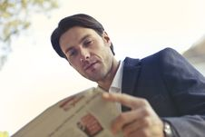 Free Low Angle Shot Of Man Reading Newspaper Royalty Free Stock Image - 109917246
