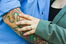 Free Man With Tattoo With A Woman In Green Top Stock Photo - 109917470