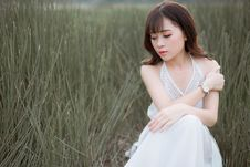 Free Woman Wearing White Halter Dress Surrounded By Grass Royalty Free Stock Images - 109917689