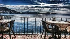 Free White Table With Two Armchair Set Near Body Of Water And Mountain Stock Photography - 109917892