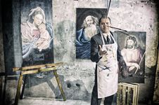 Free Painter With Apron Beside Portrait Paintings Stock Photography - 109917912