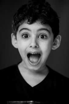 Free Boy In Black V-neck Shirt With Looking Straight To The Camera With A Shocking Face Expression Stock Photo - 109918260