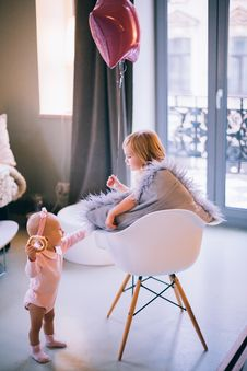 Free Baby And Girl Playing With Balloon Royalty Free Stock Image - 109918486