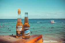 Free Two Corona Extra And San Mig Light Beers On Top Of Brown Wooden Plank Near Beach Stock Image - 109918521