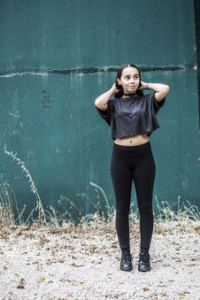 Free Woman Wearing Black Crew-neck Crop-top And Black High-waist Fitted Leggings Stock Photography - 109918522