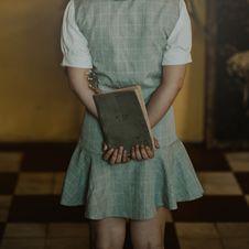 Free Woman Wearing Grey Dress Holding Book Stock Photo - 109918570