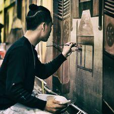 Free Man In Black Sweatshirt Holding Black Paint Brush Painting The Wall Royalty Free Stock Photo - 109918825