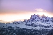 Free Mountain Cover By Snow Under Orange Sky Stock Photography - 109918852