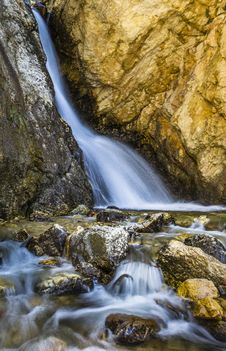 Free Water Stream Between Brown Rocks Stock Image - 109918921