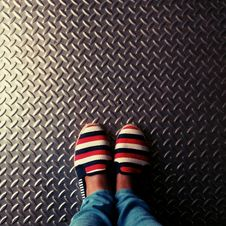 Free Person Wearing Red-and-multicolored Slip-on Shoes Standing On Gray Metallic Diamond Plate Stock Image - 109919061