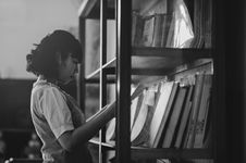 Free Grayscale Photo Of A Woman Holding A Book Inside The Library Stock Image - 109919161