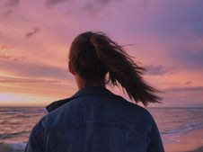 Free Woman Wearing Blue Denim Jacket Looking At The Beach Stock Image - 109919201