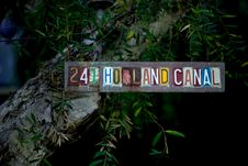 Free Multi-colored 241 Holland Canal Signage Mounted On Rock Stock Photography - 109919322
