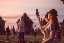 Free Woman Wearing Grey T-shirt Taking A Photo Stock Photos - 109919403