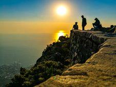 Free Three Men On Mountain Cliff Royalty Free Stock Image - 109919416