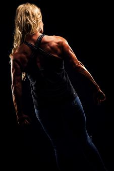 Free Woman Wearing Criss Cross Back Strap Top Flexing Stock Image - 109919771