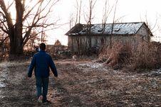 Free Man Wears Blue Jacket Near Leafless Tree Stock Images - 109919834