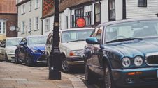 Free Four Car Parked Beside The Road Stock Photography - 109919862