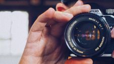 Free Person Holding Olympus Milc Camera Royalty Free Stock Photo - 109919915