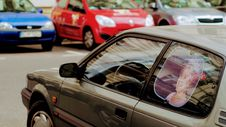 Free Gray Car With Queen Elizabeth Photo Window Visor Poster Stock Photo - 109919930