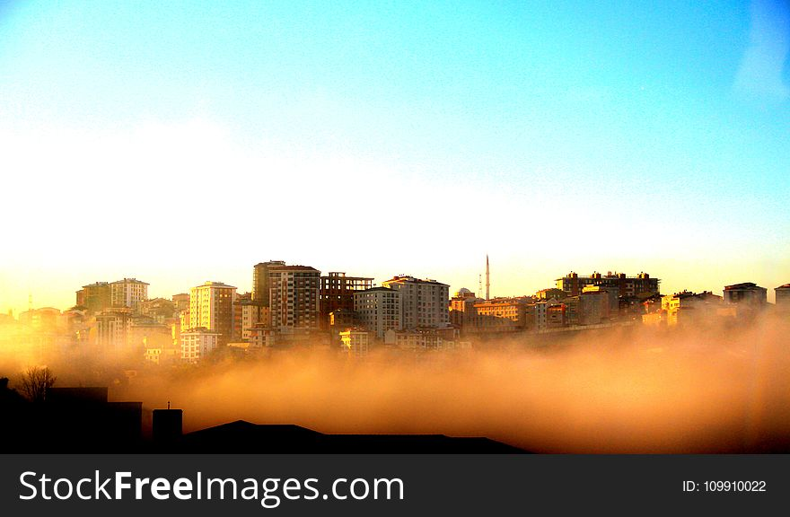 Photography of Buildings on a Foggy Morning