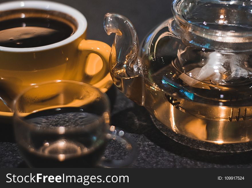 Luqiud Filled Clear Glass Teapot With Cup