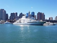 Free White Ship In A Distance Of Skyline Buildings Stock Photos - 109920013