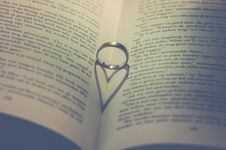 Free Photography Of Silver Ring On Book Stock Photography - 109920042