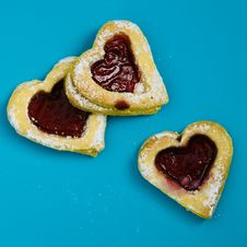 Free Heart Shaped Cookies On Blue Surface Royalty Free Stock Images - 109920119
