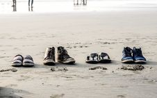 Free Photo Of Assorted Pairs Of Footwear On Sand Stock Image - 109920201