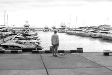 Free Man Standing On A Concrete Dock Near Body Of Water Stock Image - 109920261