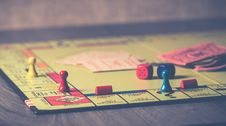 Free Monopoly Board Game On Brown Wooden Tabletop Royalty Free Stock Photo - 109920265