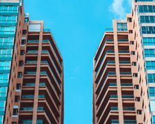 Free Low Angle View Of Two High Rise Buildings Under Blue Sky Royalty Free Stock Photo - 109920325