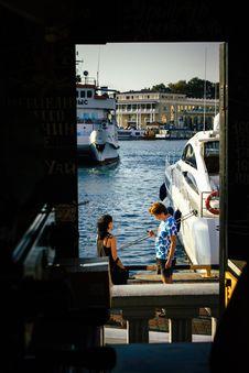 Free Man Standing Beside Woman Near White Yacht Stock Image - 109920521