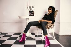 Free Woman Wearing Pair Of Purple Boots Stock Image - 109920631