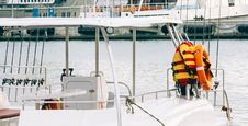 Free Photo Of White Boat With Life Vest On Side Stock Photos - 109920723