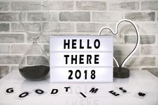 Free White Hello There 2018 Printed Board Against Gray Wall Royalty Free Stock Photography - 109920767