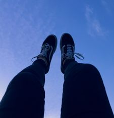 Free Person Wearing Vans Old Skool Sneakers Raising His Feet Pointing To They Sky Royalty Free Stock Photo - 109920875